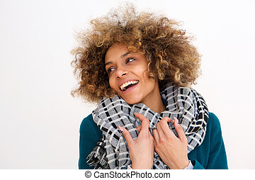 Portrait of beautiful african american woman smiling with winter coat against white background