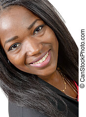 Portrait of beautiful African American young woman smiling, on white background