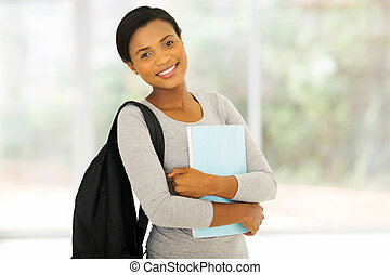 african college student holding a book
