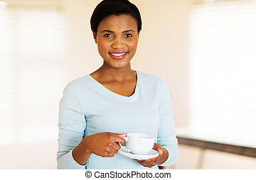 african girl drinking coffee