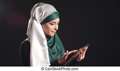 Portrait of Beautiful Arabic Muslim Girl Using Mobile Phone....