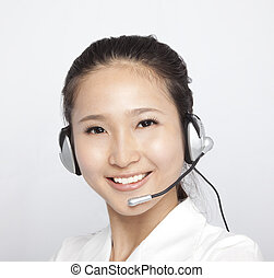 portrait of beautiful asian Customer Representative with headset