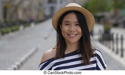 Portrait of beautiful asian girl smiling brightly