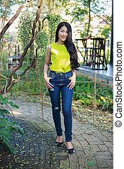 portrait of beautiful asian woman in garden