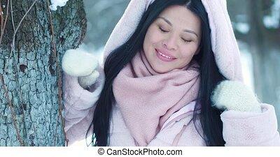 Portrait of beautiful asian woman in winter park. - Portrait...