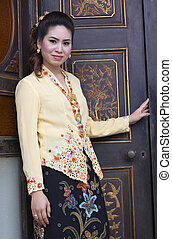portrait of beautiful asian woman smiling with traditional...