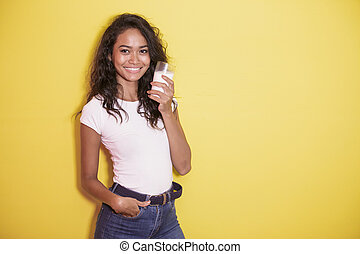 beautiful asian woman with a glass of fresh milk