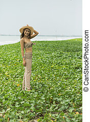 portrait of beautiful asian younger woman standing on natural sea beach
