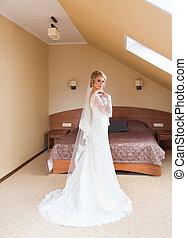 Portrait of beautiful attractive bride. Wedding dress.