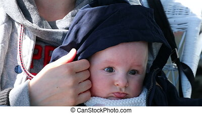 Portrait Of Beautiful Baby Boy With Blue Hood on His Head