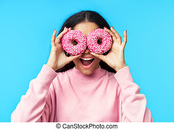 Portrait of beautiful black woman and donuts