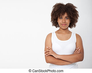 Portrait of beautiful black woman isolated. Atractive brunette dark-skinned woman in a white tank top.