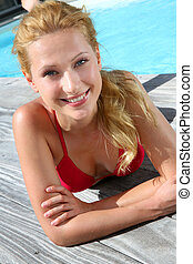 Portrait of beautiful blond girl in red bikini