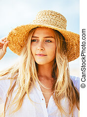Portrait of beautiful blond girl on the beach