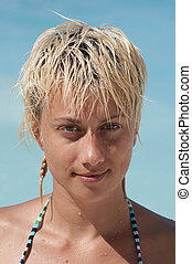 Portrait of beautiful blond woman in bikini