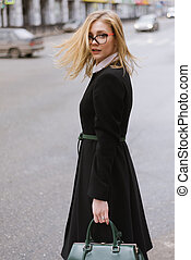 Portrait of beautiful blond woman in coat