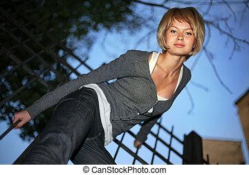 Portrait of beautiful blond woman outdoors. Shallow DOF.