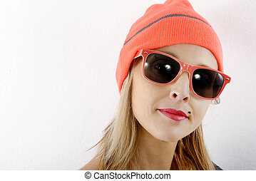 beautiful blond woman with winter hat and sunglasses