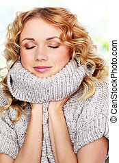 Portrait of beautiful blond woman with wool sweater