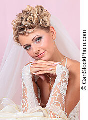 Portrait of beautiful blonde bride with makeup wearing in Classi
