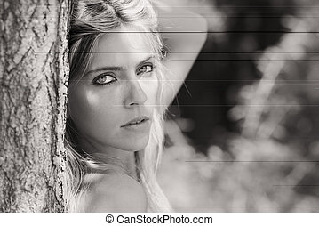 Portrait of beautiful blonde girl in black and white