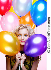 blonde girl with balloons