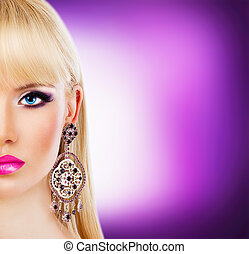 Portrait of beautiful blonde girl with purple makeup
