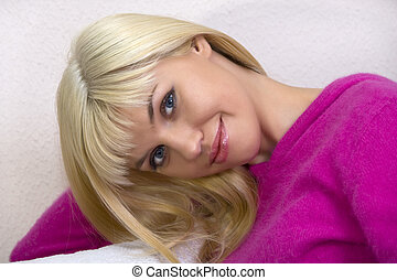 Portrait of beautiful blonde in pink sweater