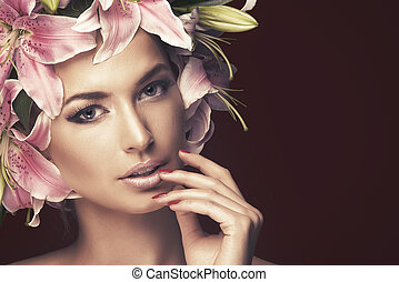 Portrait of beautiful blonde with blue eyes wearing flowers in her hair