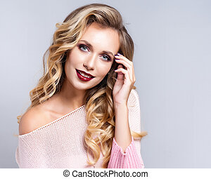 Portrait of beautiful blonde woman with curly hairstyle and bright makeup.  Natural look. studio, isolated.