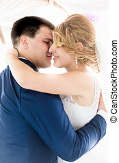beautiful bride and groom kissing at first dance