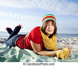 Portrait of beautiful brunet girl in cap