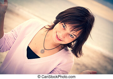 beautiful brunet girl on the beach.