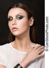 Portrait of beautiful brunet woman with fashion make-up