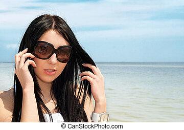 beautiful brunette speaking on the phone