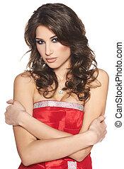 Portrait of beautiful brunette woman in red dress
