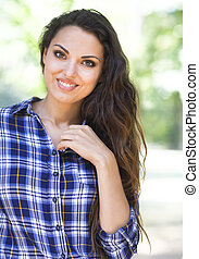 Portrait of beautiful brunette woman looking at camera