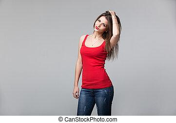 Portrait of beautiful brunette woman posing in studio