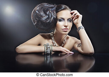 Portrait of beautiful brunette woman wearing jewellery
