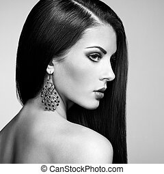 Portrait of beautiful brunette woman with earring