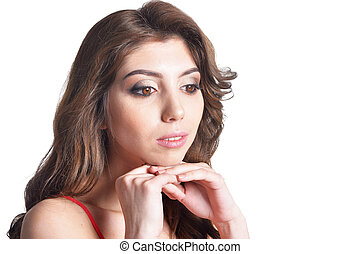 Portrait of beautiful brunette young woman on white background