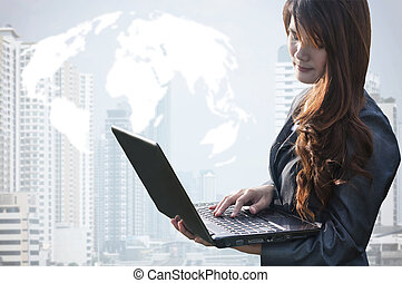Portrait of beautiful business woman working on a laptop