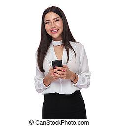 portrait of beautiful businesswoman sending a text message