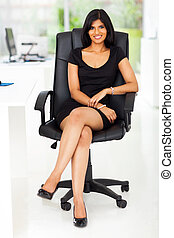 beautiful businesswoman sitting in modern office