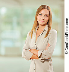 portrait of beautiful businesswoman with crossed arms