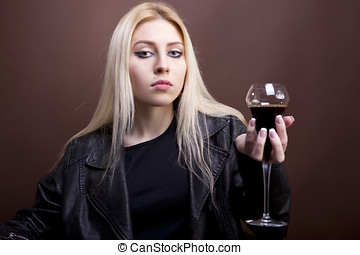 Portrait of beautiful caucasian girl with a glass in her hand