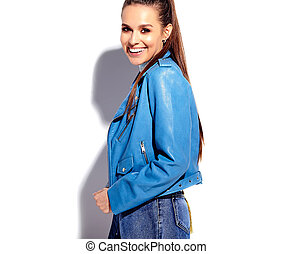 Portrait of beautiful caucasian smiling brunette woman model in bright blue jacket isolated on white background