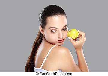beautiful caucasian woman with an apple in her hand