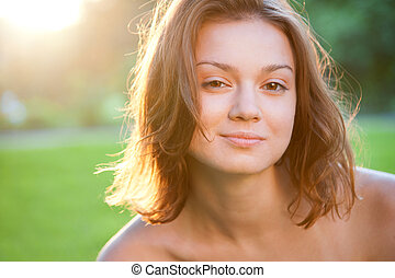 Portrait of beautiful charming smiling woman