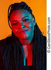 Portrait of beautiful confident African American woman, closeup.